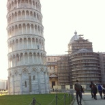 Nathan approaches the leaning tower of Pisa.