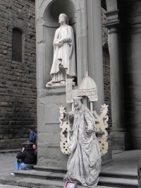 Street performer blends in with the famous statues in Florence.