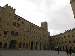 A large square in Volterra. A trumpet player practices a few notes that echo throughout the narrow streets forever perserved in the year 1398.