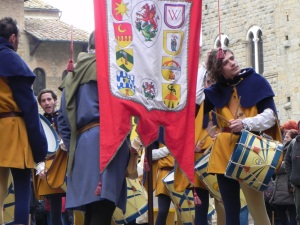 A medieval reenactment takes place in Volterra. The participants get ready for a march through the streets.