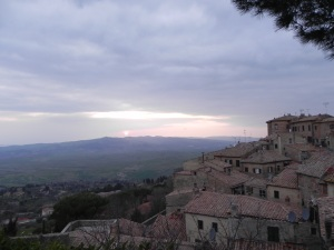 The sun sets over the medieval village of Volterra.