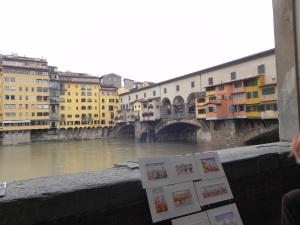 Looking over the souvenirs at the Ponte Vecchio, the only bridge to have survived the Nazi occupation.