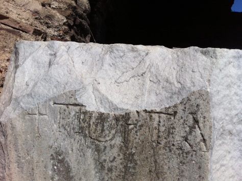 Greek writing on a collapsed column from the wall of Constantinople